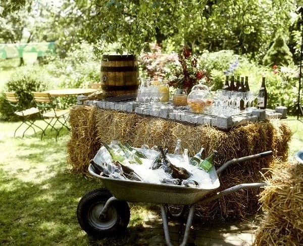 chic rustic hay bale wedding serving table and drinks
