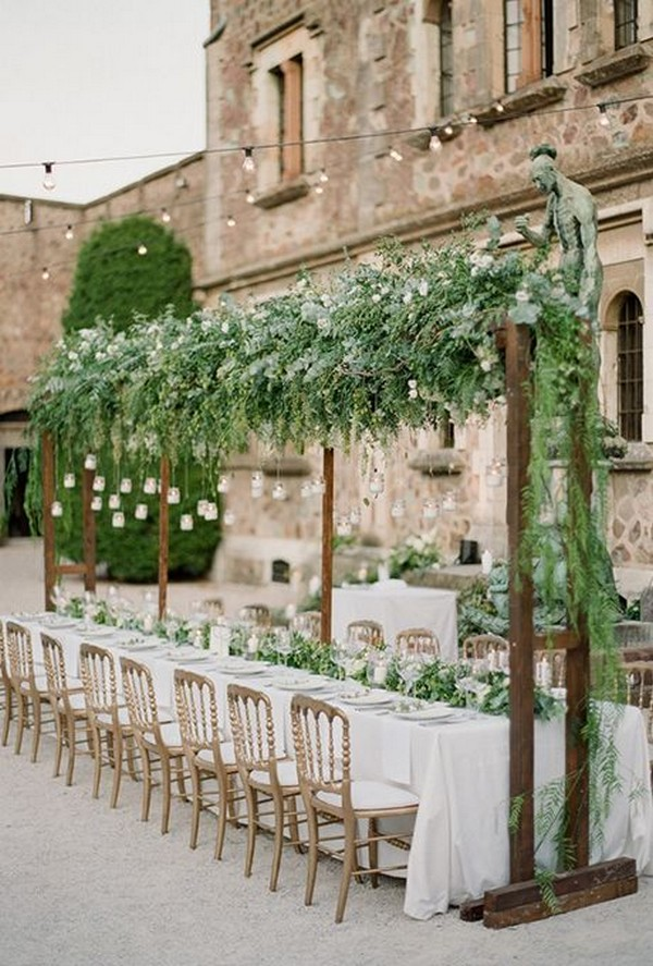 chic rustic wedding reception arbor with hanging greenery