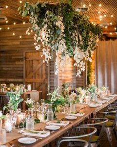 chic rustic wedding reception decorations with hanging white and greenery floral