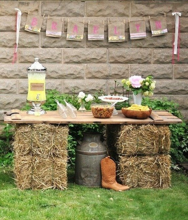country hay bales and boards outdoor wedding bar station
