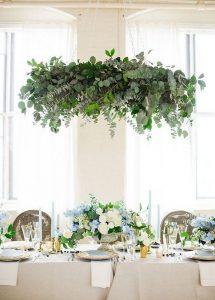 elegant hanging greenery installation wedding decorations
