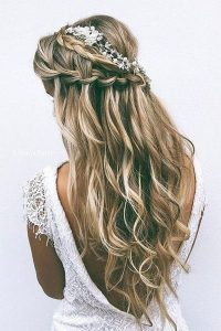 half up half down bridal hairstyle with baby's breath