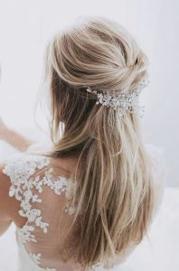 half up half down bridal hairstyle with hairpin
