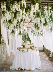 hanging white and green floral for tented wedding ideas