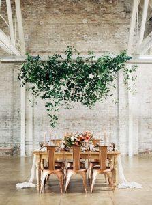 modern industrial wedding reception ideas with hanging greenery