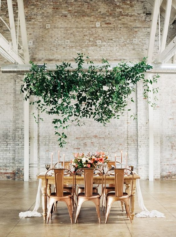 modern industrial wedding reception ideas with hanging greenery
