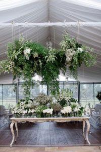 modern wedding decoration ideas with hanging greenery