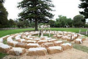 rounded wedding ceremony seatings with hay bales