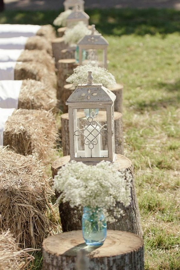 rustic hay bale wedding ceremony seatings with covers and lanterns