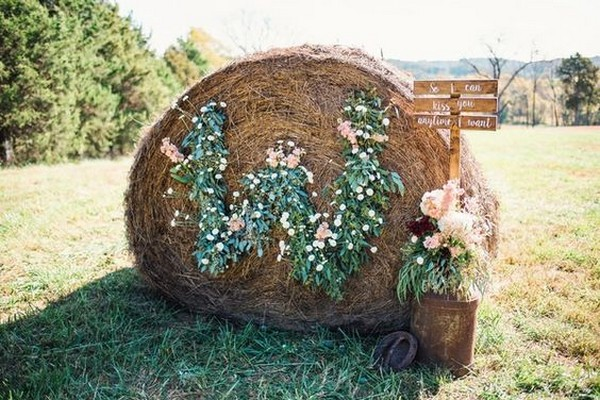 rustic hay bale wedding sign and decorations