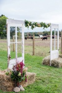 rustic outdoor wedding arch decorations with hay bales
