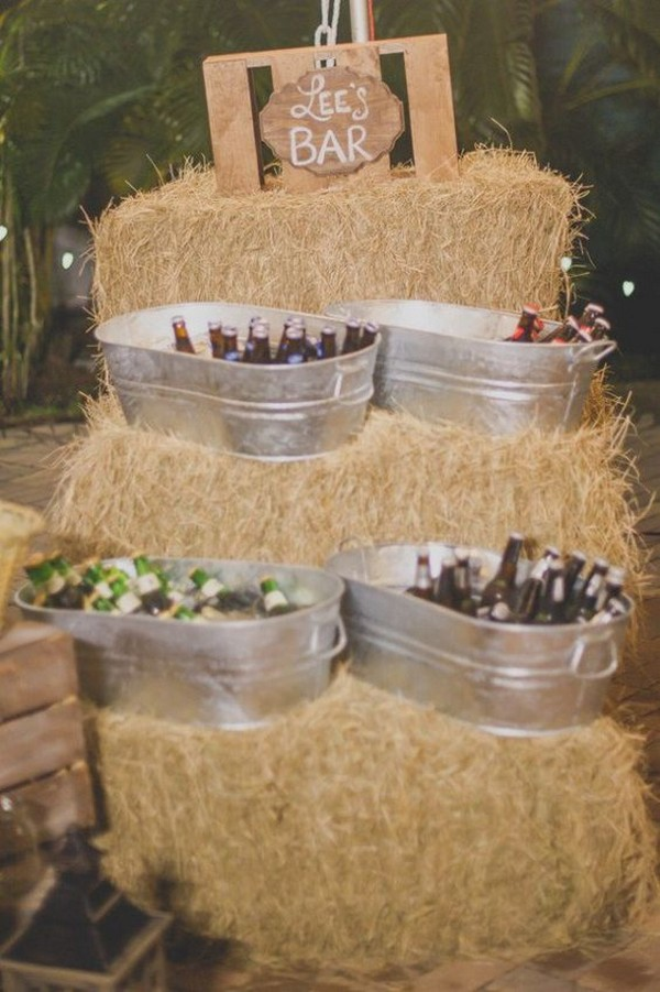 rustic wedding drink station with hay bales