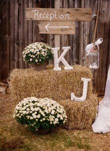 rustic wedding sign decorated with hay bales
