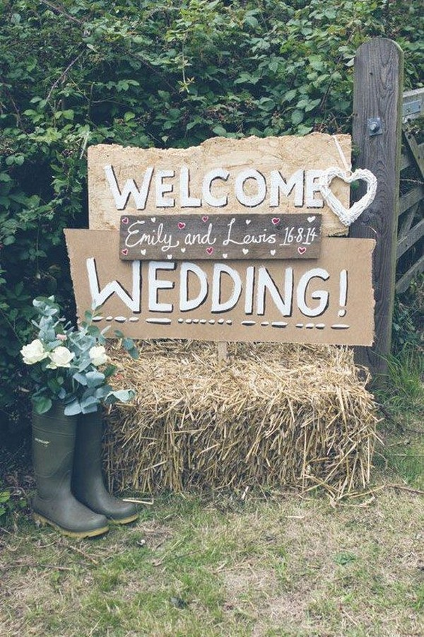 rustic wedding sign ideas with hay bale