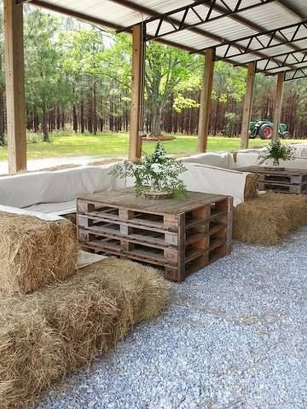 tented rustic farm ideas with hay bale seatings