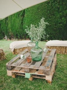 tented wedding ideas with hay bale seating area