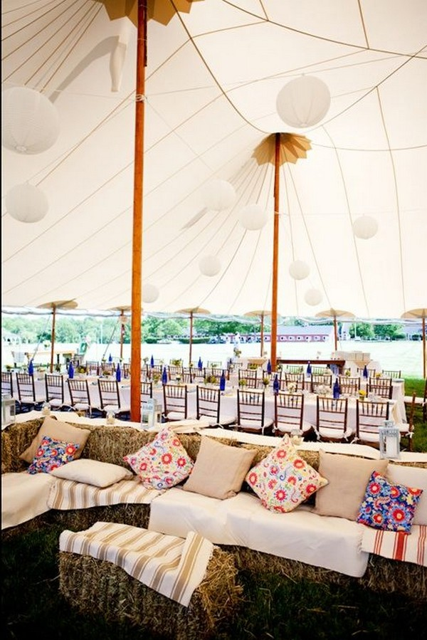 tented wedding receptions with hay bale sofa