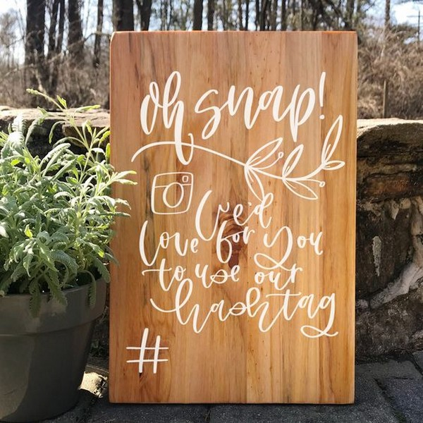 wooden wedding hashtag sign