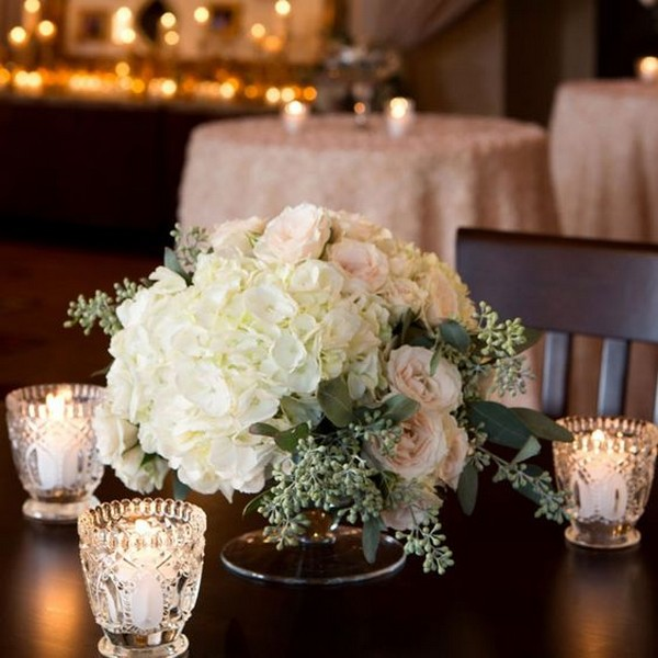 Hydrangea Roses And Eucalyptus wedding centerpiece