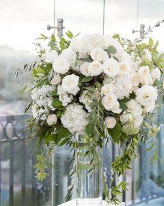 Hydrangea blush garden roses and eucalyptus wedding centerpiece