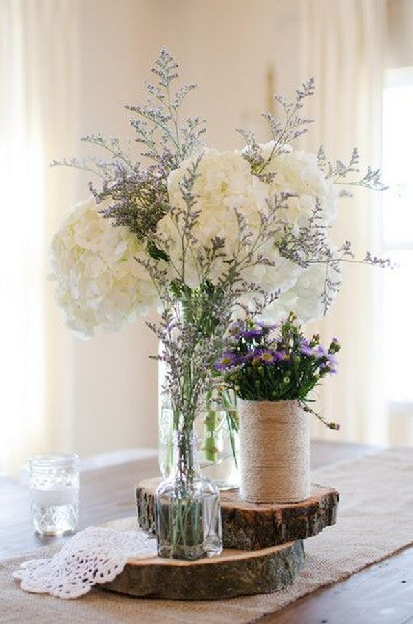 chic rustic lavender wedding centerpiece with wine bottle and mason jars