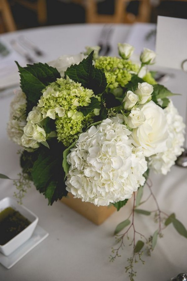 chic white and green hydrangea and eucalyptus wedding centerpiece