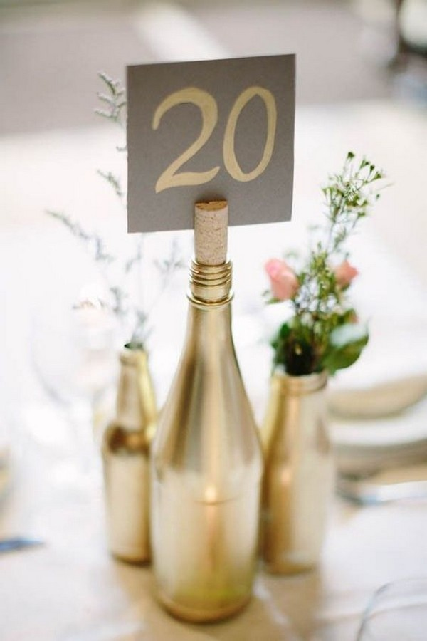 metallic gold painted wine bottle wedding centerpieces