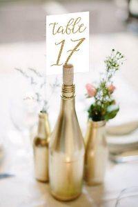 metallic gold wine bottles wedding centerpiece