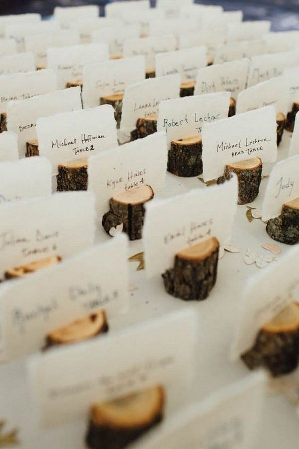 mini tree stumps fall wedding escort card ideas