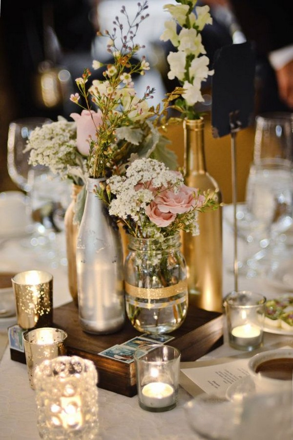romantic wedding centerpiece with wine bottles and candles