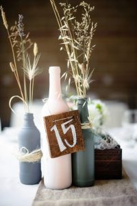 rustic chic painted wine bottles wedding centerpiece