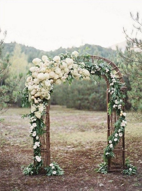 rustic wedding arch with white flowers and branches
