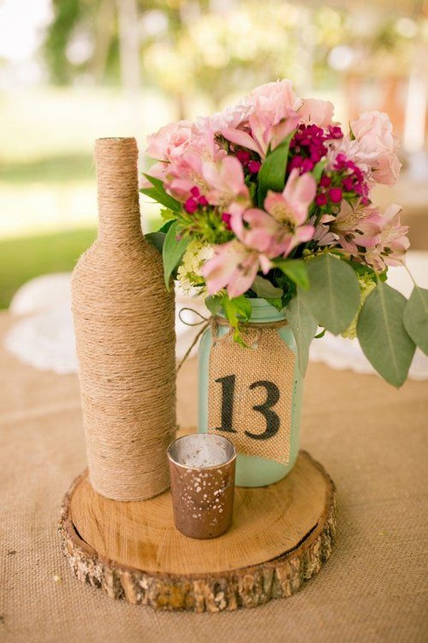 rustic wedding centerpiece with wrapped wine bottle and mason jar