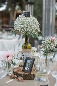 rustic wine bottle wedding centerpiece with baby's breath