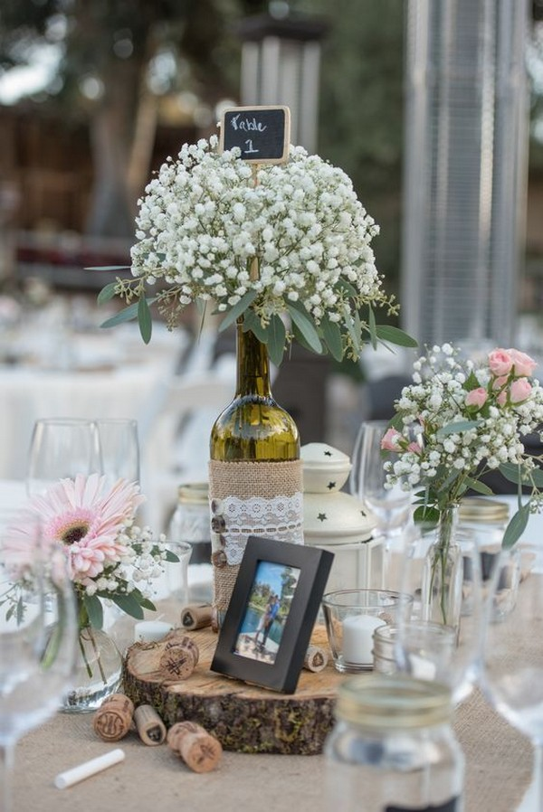 rustic wine bottle wedding centerpiece with baby's breath