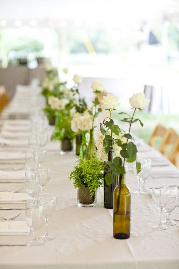 simple greenery wedding centerpieces with wine bottles