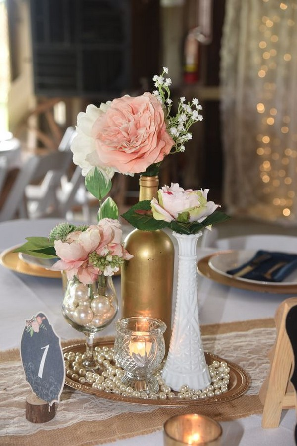 vintage wedding centerpiece ideas with pearls and metallic wine bottle