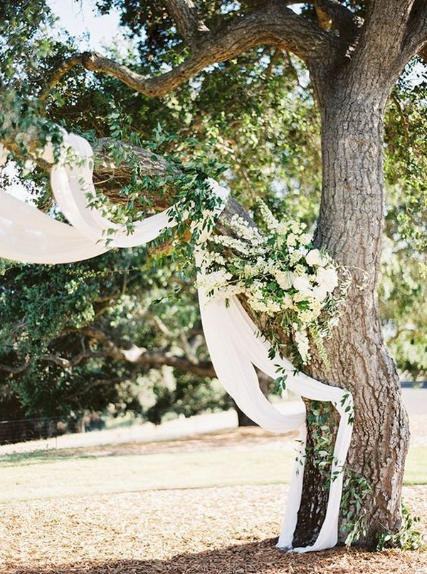 woodland themed wedding arch and backdrop ideas