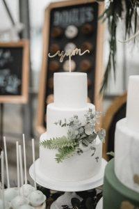 simple elegant white and green wedding cake