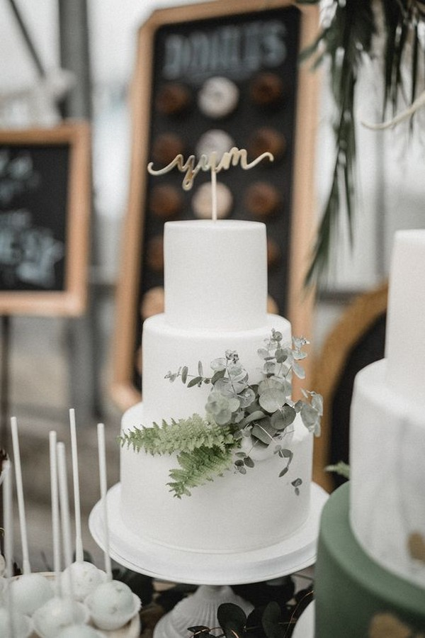 simple elegant white and green wedding cake