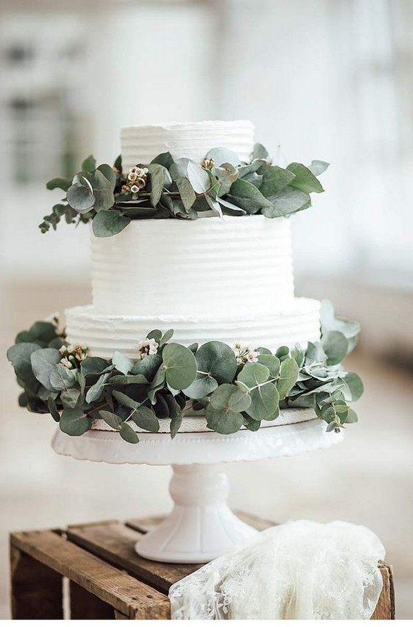 white and greenery elegant wedding cake