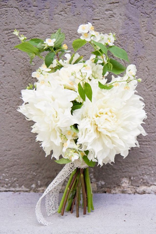 all white dahlia wedding bouquet with greenery