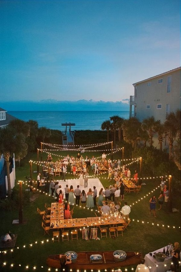 beachside night wedding reception ideas with string lights