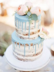 blush pink and blue semi naked drip wedding cake