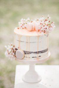 blush pink drip wedding cake for spring