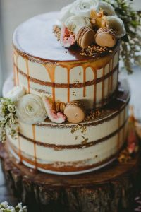 caramel drip wedding cake with figs and macaroons
