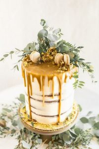 chic greenery and yellow drip wedding cake
