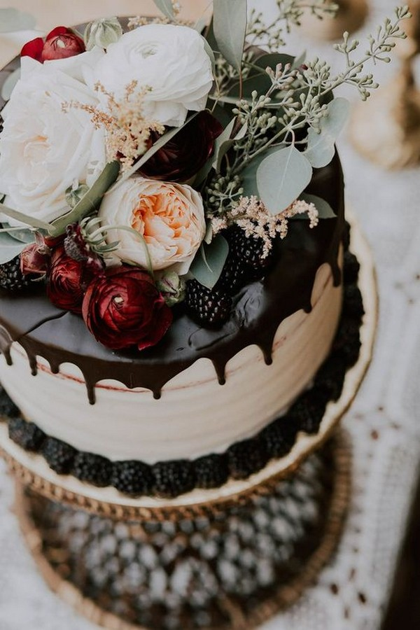 chocolate drip wedding cake with autumnal florals