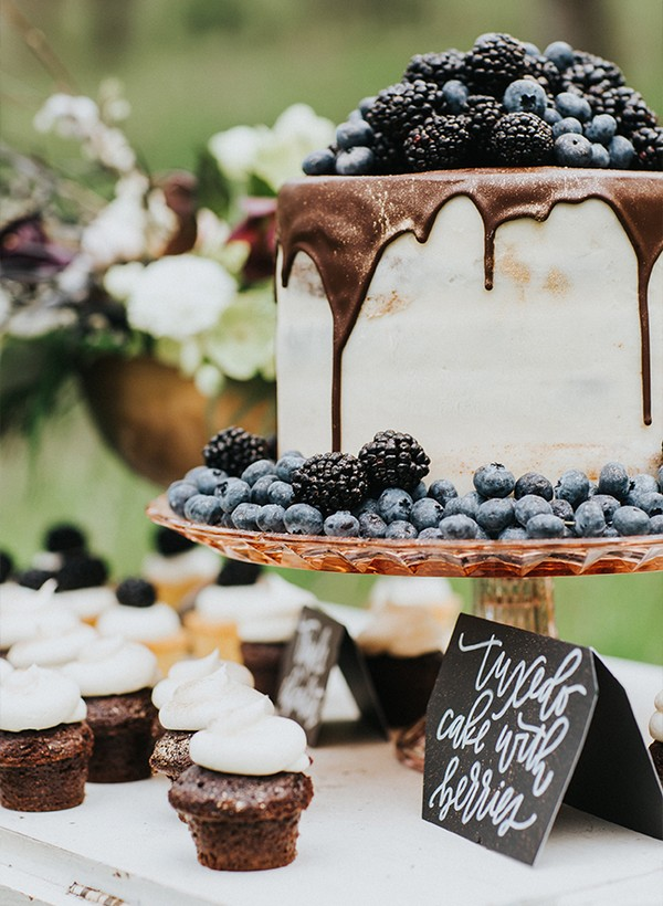 chocolate drip wedding cake with berries