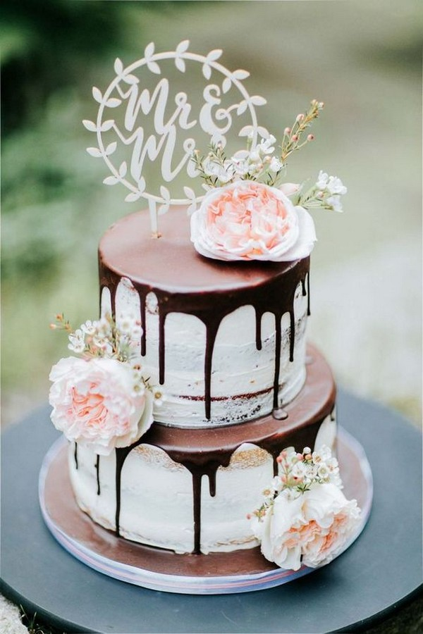 chocolate drip wedding cake with blush floral